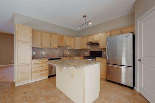 Photo 11: #6 8403 164 Avenue in Edmonton: Zone 28 Townhouse for sale : MLS®# E4229127