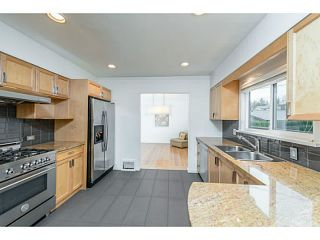 Photo 2: 2057 W 63RD Avenue in Vancouver: S.W. Marine House for sale (Vancouver West)  : MLS®# V1038975