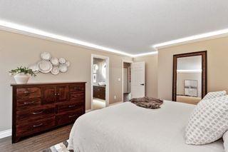 """Photo 18: 8215 STRAUSS Drive in Vancouver: Champlain Heights Townhouse for sale in """"Ashleigh Heights"""" (Vancouver East)  : MLS®# R2565596"""