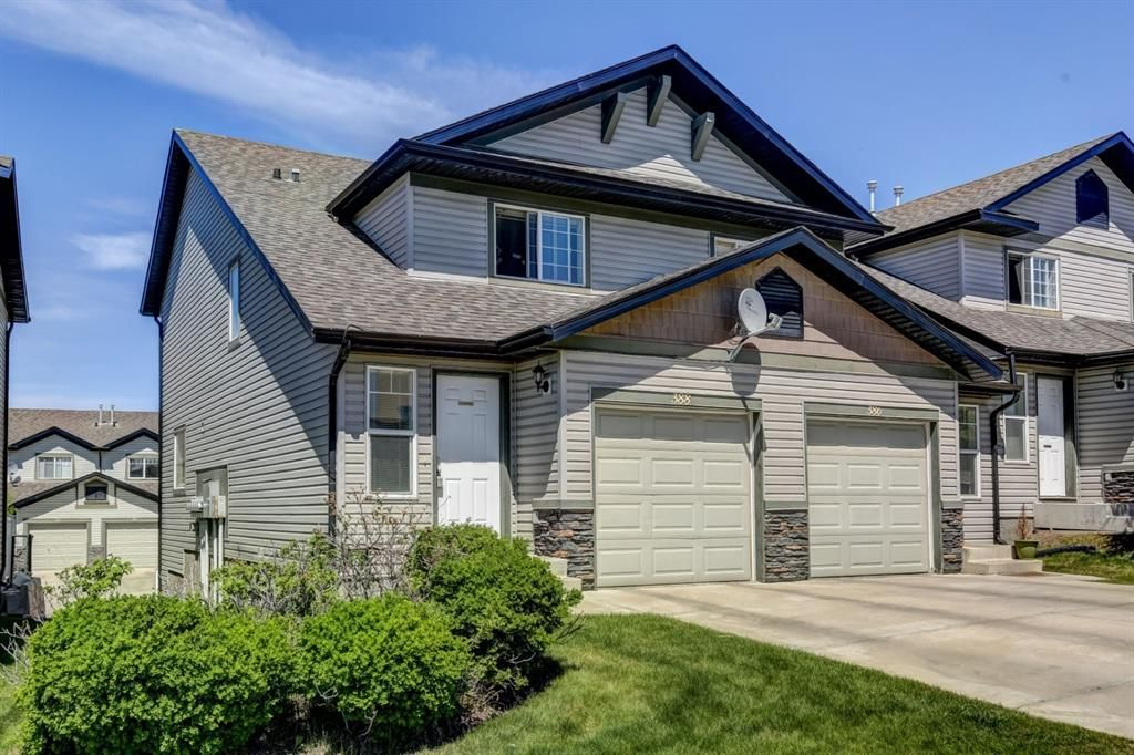 Main Photo: 388 Panatella Boulevard NW in Calgary: Panorama Hills Row/Townhouse for sale : MLS®# A1114400