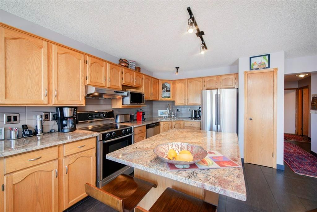 Photo 10: Photos: 142 Arbour Summit Close NW in Calgary: Arbour Lake Detached for sale : MLS®# A1102229