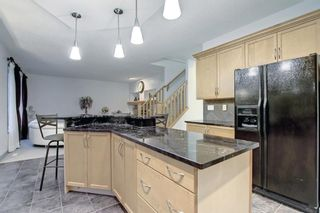 Photo 13: 163 Springbluff Heights SW in Calgary: Springbank Hill Detached for sale : MLS®# A1153228
