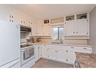 """Photo 12: 34680 2ND Avenue in Abbotsford: Poplar House for sale in """"HUNTINGDON VILLAGE"""" : MLS®# R2528448"""