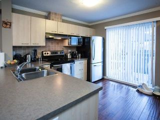 """Photo 10: 44 20176 68TH Avenue in Langley: Willoughby Heights Townhouse for sale in """"Steeple Chase"""" : MLS®# F1401877"""