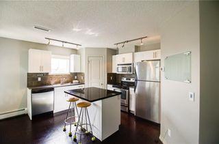 Photo 4: 50 Auburn Bay Common SE in Calgary: Auburn Bay Row/Townhouse for sale : MLS®# A1128928