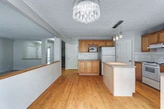 Photo 16: 7854 Springbank Way SW in Calgary: Springbank Hill Detached for sale : MLS®# A1142392