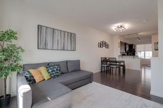 Photo 10: 111 Ascot Point SW in Calgary: Aspen Woods Row/Townhouse for sale : MLS®# A1144877
