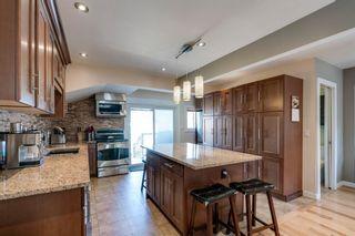 Photo 2: 618 12 Avenue NE in Calgary: Renfrew Detached for sale : MLS®# A1081491