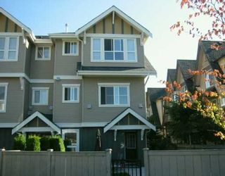 """Photo 1: 7833 HEATHER Street in Richmond: McLennan North Townhouse for sale in """"Belmont"""" : MLS®# V629931"""