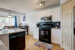 Photo 4: 445 Bridlewood Court SW in Calgary: Bridlewood Detached for sale : MLS®# A1121282