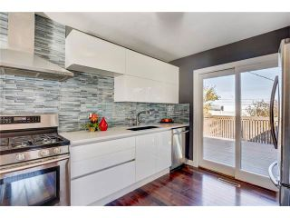 Photo 8: 5612 LADBROOKE Drive SW in Calgary: Lakeview House for sale : MLS®# C4036600