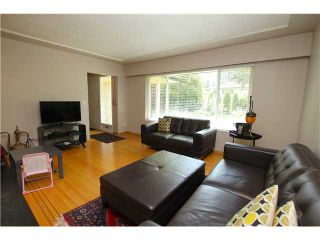 Photo 2: 1571 HARBOUR Drive in Coquitlam: Harbour Place House for sale : MLS®# V1079312