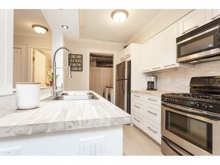"Photo 11: 513 34909 OLD YALE Road in Abbotsford: Abbotsford East Condo for sale in ""The Gardens"" : MLS®# R2486024"