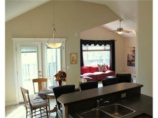 Photo 8: 68 CRYSTAL SHORES Place: Okotoks House for sale : MLS®# C4066673