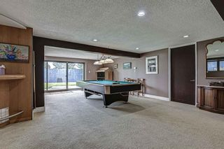 Photo 32: 512 Coach Grove Road SW in Calgary: Coach Hill Detached for sale : MLS®# A1127138
