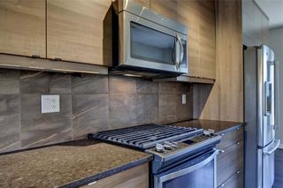 Photo 12: 102 501 RIVER HEIGHTS Drive: Cochrane Row/Townhouse for sale : MLS®# C4266118