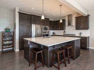 Photo 5: 46 RIVIERA Way: Cochrane Row/Townhouse for sale : MLS®# C4281559