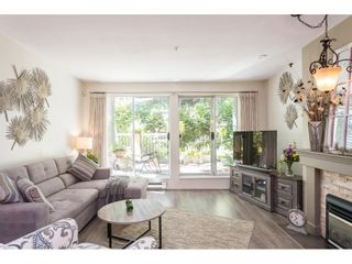 """Photo 3: 102 2733 ATLIN Place in Coquitlam: Coquitlam East Condo for sale in """"ATLIN COURT"""" : MLS®# R2475795"""