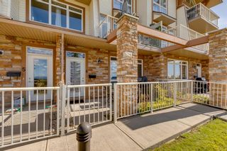 Photo 2: 6 133 Rockyledge View NW in Calgary: Rocky Ridge Apartment for sale : MLS®# A1147777