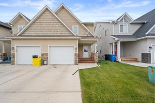 Photo 1: 17 Deer Coulee Drive: Didsbury Semi Detached for sale : MLS®# A1140934