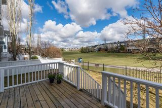 Photo 5: 48 Moreuil Court SW in Calgary: Garrison Woods Detached for sale : MLS®# A1104108