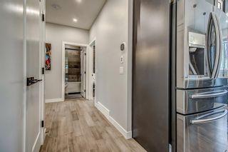 Photo 13: 715 71 Avenue SW in Calgary: Kingsland Detached for sale : MLS®# A1134081