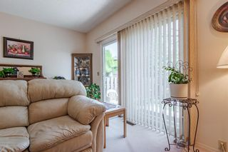 Photo 16: 166 Glamis Terrace SW in Calgary: Glamorgan Row/Townhouse for sale : MLS®# A1119592