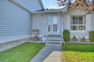 Photo 2: 124 Deer Ridge Close SE in Calgary: Deer Ridge Semi Detached for sale : MLS®# A1129488