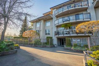 "Photo 1: 101 7505 138 Street in Surrey: East Newton Condo for sale in ""Mid Town Villas"" : MLS®# R2571497"