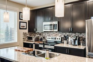 Photo 9: 105 Rainbow Falls Boulevard: Chestermere Semi Detached for sale : MLS®# A1144465