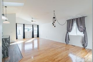 Photo 9: 48 West Springs Way SW in Calgary: West Springs Row/Townhouse for sale : MLS®# A1148807