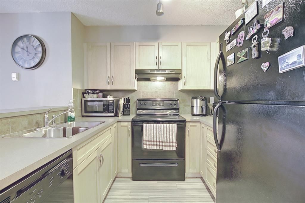 Photo 7: Photos: 2211 43 Country Village Lane NE in Calgary: Country Hills Village Apartment for sale : MLS®# A1085719