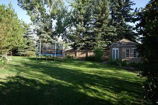 Photo 8: 505 Suntree Place: Okotoks Detached for sale : MLS®# A1110721