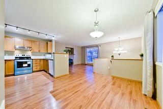 Photo 10: 10 BRIDLEGLEN RD SW in Calgary: Bridlewood House for sale : MLS®# C4291535