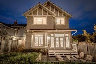 Photo 1: 1380 E 17TH Avenue in Vancouver: Knight 1/2 Duplex for sale (Vancouver East)  : MLS®# R2090991