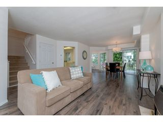 """Photo 5: 210 13900 HYLAND Road in Surrey: East Newton Townhouse for sale in """"Hyland Grove"""" : MLS®# R2295690"""