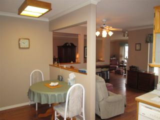 """Photo 4: 210 2451 GLADWIN Road in Abbotsford: Abbotsford West Condo for sale in """"Centennial Court"""" : MLS®# R2145469"""