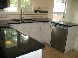 Photo 2: 1832 76 Avenue SE in Calgary: Lynnwood_Riverglen House for sale : MLS®# C4026805