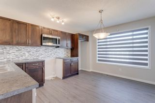 Photo 8: 162 AUBURN BAY Boulevard SE in Calgary: Auburn Bay Semi Detached for sale : MLS®# A1114634