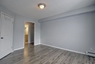 Photo 35: 7402 304 MacKenzie Way SW: Airdrie Apartment for sale : MLS®# A1081028
