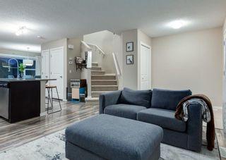 Photo 7: 40 EVANSRIDGE Court NW in Calgary: Evanston Row/Townhouse for sale : MLS®# A1095762
