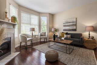 """Photo 1: 8583 AQUITANIA Place in Vancouver: South Marine Townhouse for sale in """"SOUTHAMPTON"""" (Vancouver East)  : MLS®# R2608907"""