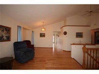 Photo 8: 31 RIVERVIEW Close: Cochrane House for sale : MLS®# C4055630