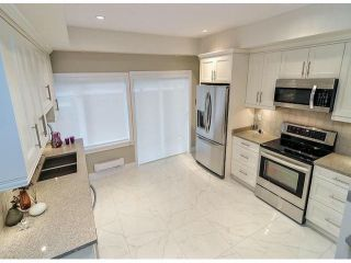 """Photo 6: 1810 E PENDER Street in Vancouver: Hastings Townhouse for sale in """"AZALEA HOMES"""" (Vancouver East)  : MLS®# V1051694"""