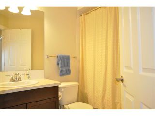 Photo 12: 118 WINDSTONE Crescent SW: Airdrie Townhouse for sale : MLS®# C3590682