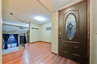 Photo 2: EDGEMONT ESTATES DR NW in Calgary: Edgemont House for sale : MLS®# C4221851