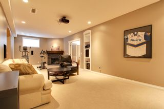 Photo 15: 131 Cougar Plateau Circle SW in Calgary: 2 Storey for sale : MLS®# C3614218