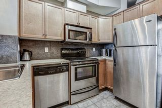 Photo 2: 7 124 Rockyledge View NW in Calgary: Rocky Ridge Row/Townhouse for sale : MLS®# A1111501