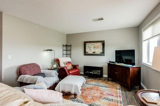 Photo 5: 401 300 Edwards Way NW: Airdrie Apartment for sale : MLS®# A1111826