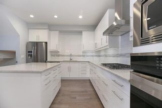 Photo 4: 2 4713 17 Avenue NW in Calgary: Montgomery Row/Townhouse for sale : MLS®# A1135543